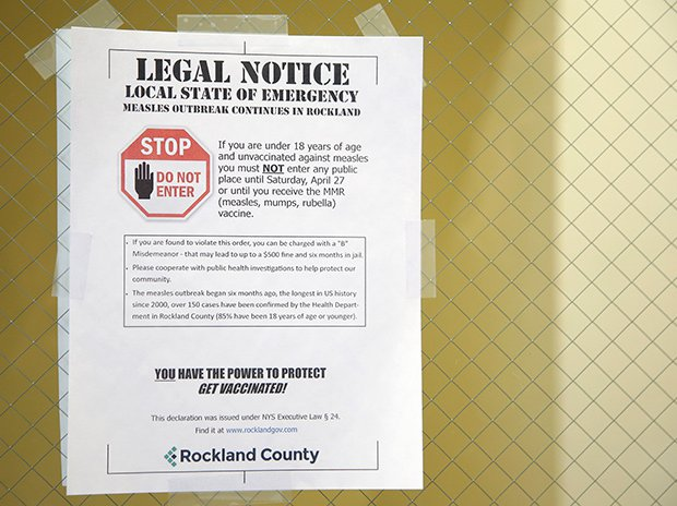 A sign from March 27, 2019 explaining the local state of emergency is displayed at the Rockland County Health Department in Pomona, N.Y.