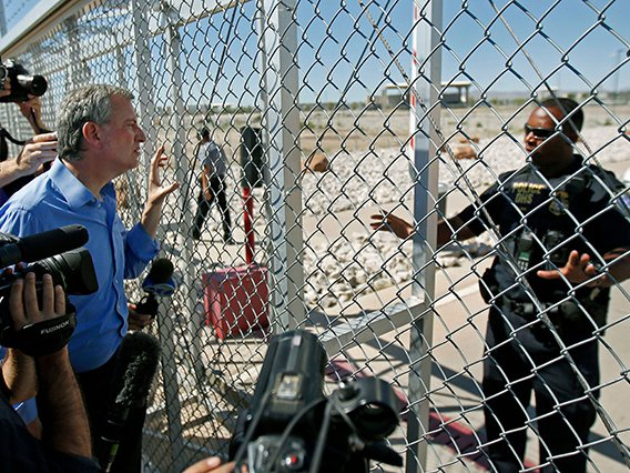 An agent with the Department of Homeland Security denies access to New York City Mayor Bill de Blasio to the holding facility for immigrant children in Tornillo, Texas, near the Mexican border in June 2018.