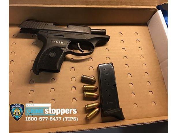 A photograph of the suspect's gun