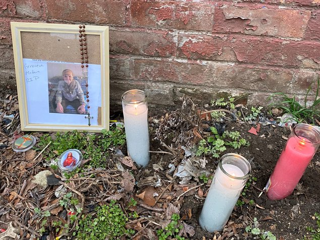 A photograph of Genoveva Mardera outside an apartment building, with three candles.