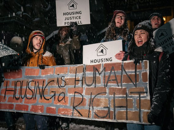 Protesters marched during a snowstorm in November to demand tougher rent protections.