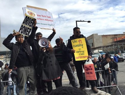 Uber drivers protesting outside of the Uber offices in Long Island City on Monday