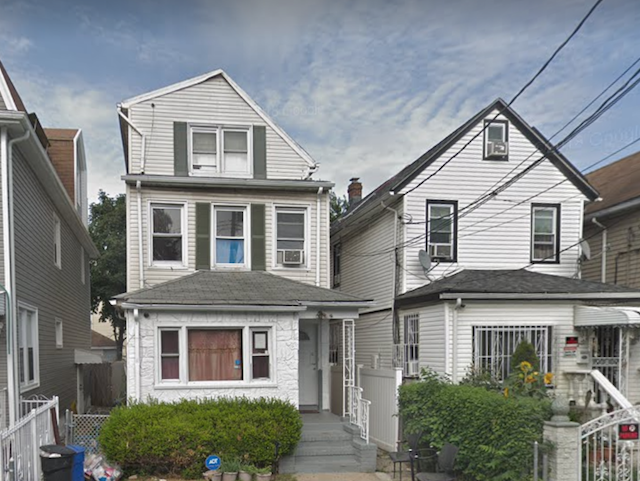 The Jamaica, Queens, house where police say Rizwan was shot, on the left