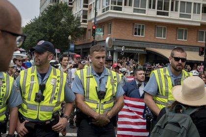 Jason Kessler, holding a flag<br>