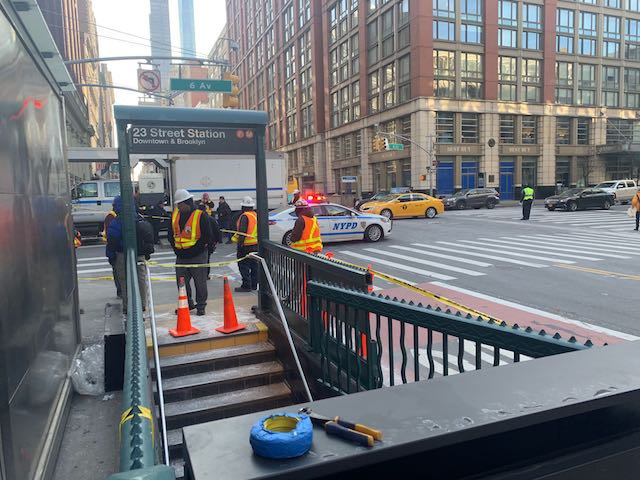 A tractor trailer crashed into the entrance to the F and M trains at 23rd Street and 6th Avenue.