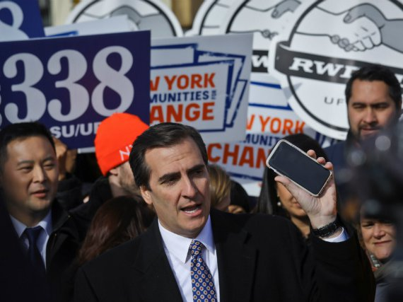 In November, New York State Sen. Michael Gianaris, center, calls on supporters to remove the Amazon app from their phones and boycott the compony, as he address a coalition rally and press conference