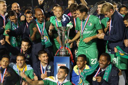 The Cosmos celebrate their first NASL Soccer Bowl championship since 1982.