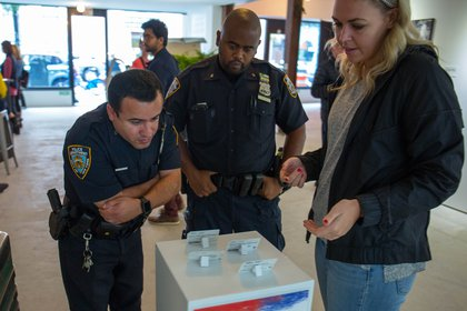 Police officers look at the exhibit<br>