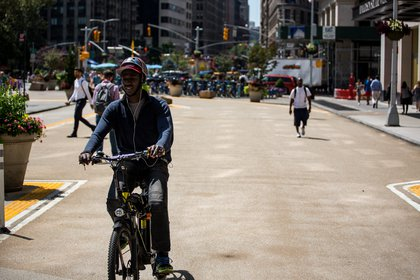 A Seamless delivery worker takes advantage of the new northbound stretch of Broadway between West 24th and 25th Streets.</br>
