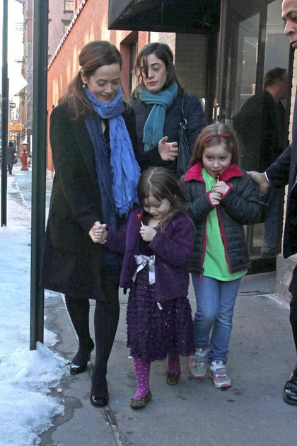 Hoffman's partner, Mimi O'Donnell, and their daughters Willa and Tallulah, outside their West Village home, leaving for the wake (Pacific Coast News)
