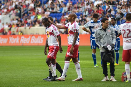 Henry consoles injured teammate Bradley Wright-Phillips.