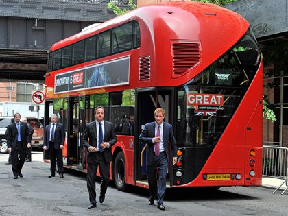 Oh, look—Prince Harry brought a double-decker bus AND Prime Minister David Cameron!