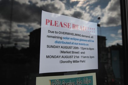 A sign in the window of the Metropolis Chamber of Commerce tells visitors of a short supply of solar eclipse viewing glasses on August 17, 2017 in Metropolis, Illinois. Metropolis is located along the eclipse path of totality in Southern Illinois.<br>