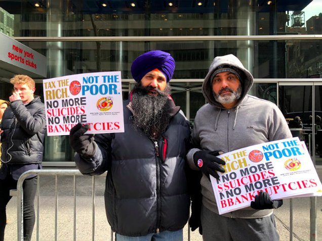 Two cab drivers at Wednesday's protest outside Governor Cuomo's office