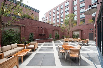 """50 North 5th's two-tiered courtyard features a waterfall of sorts. """"You can reserve this space for barbecues or events,"""" Maundrell says. """"Weddings.""""<br/>"""