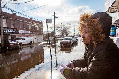 Lifelong Howard Beach resident Barbara Sarter survey's the morning floods on 102nd Street in Howard Beach<br/>