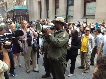 At 5 p.m. a U.S. Park Police officer tells protesters the museum is closed, and that there is no sleeping or camping