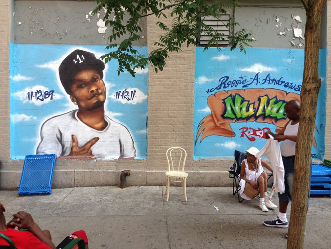 """This work memorializes Reggie Andrews, aka Nu Nu. He was shot and killed outside his home on November 12, 2011—<a href=""""http://www.dnainfo.com/new-york/20111113/harlem/reggie-andrews-shot-death-outside-home-on-birthday"""">his birthday</a>. The artist is Topaz. Located at 111th St and 5th Ave."""