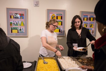 Staff from Care for the Homeless and Urban Pathways serve dinner to attendees before the memorial service.<br/>