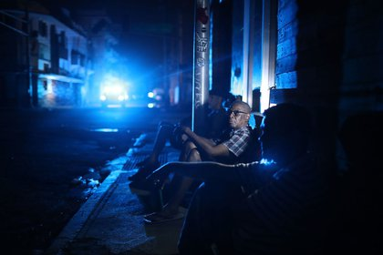 Jaime Degraff sits outside as he tries to stay cool as people wait for the damaged electrical grid to be fixed after Hurricane Maria on Saturday, September 23rd in San Juan, Puerto Rico. (Joe Raedle/Getty Images)