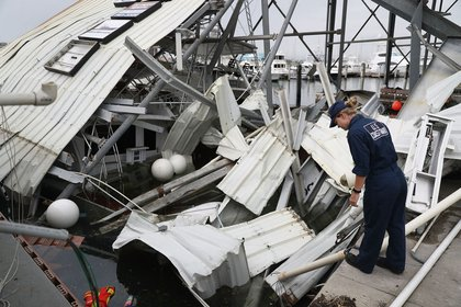 U.S. Coast Guard MST-2 Annaliese Ennis surveys the damage to a marina after Hurricane Maria passed through the area on Saturday, September 23rd in San Juan, Puerto Rico. (Joe Raedle/Getty Images)