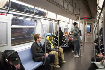 Commuters in an L train on February 6, 2019<br>