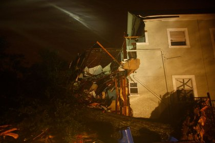 Rain from Hurricane Irma continues to pelt an apartment destroyed by a fallen tree in the early morning hours on September 11, 2017 in Lakeland, Florida. (Getty)