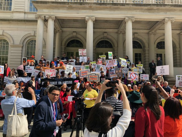 Tenants and state representatives gather outside City Hall before they testified at a state hearing on rent reform laws in Lower Manhattan on Thursday.