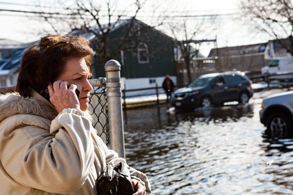 Stranded by the floods, Dotty Marlow of Ozone Park calls a friend who lives nearby<br/>