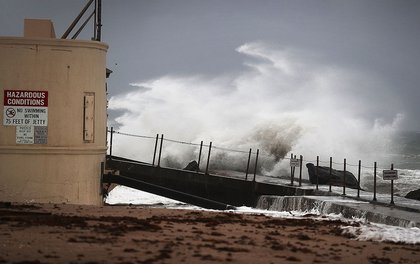 Waves crash ashore as Hurricane Matthew approaches the area on October 6, 2016 in Singer Island (Getty Images)