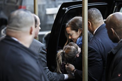O'Donnell carrying a sleeping Willa into the Frank E. Campbell Funeral Home (Getty Images)