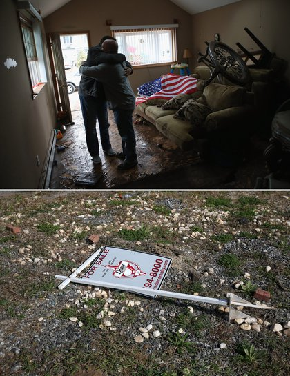 [Top] Homeowner Michael Russo (R), is comforted by friend Joseph Bono on November 1, 2012 in the Ocean Breeze area of Staten Island. The first floor of Russo's home was completely flooded by the ocean surge caused by superstorm Sandy. [Bottom] A 'for sale' sign lies on an empty lot where Joseph Bono's home was demolished due to Hurricane Sandy flood damage on October 17, 2013.