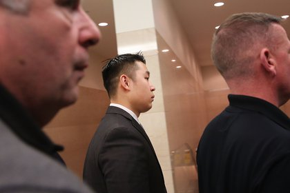 Liang inside the courthouse<br/>