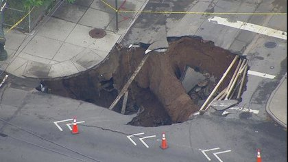 "Courtesy <a href=""http://www.myfoxny.com/story/29703402/massive-sinkhole-in-brooklyn"">Fox 5</a>"