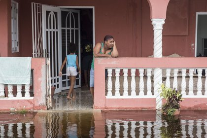 Residents look at flood waters days after Hurricane Maria made landfall, on Friday, September 22 in Loiza, Puerto Rico. (Alex Wroblewski/Getty Images)