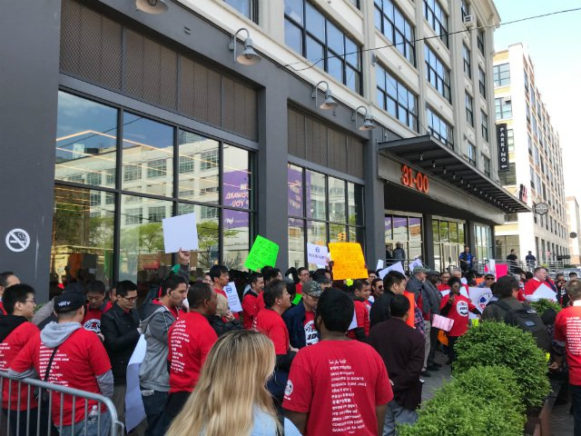 Drivers rally outside Uber's headquarters in Long Island City on Wednesday