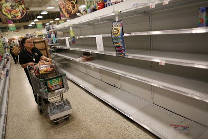 Empty shelves in a Miami grocery store on September 6, 2017.  (Photo by Joe Raedle/Getty Images)