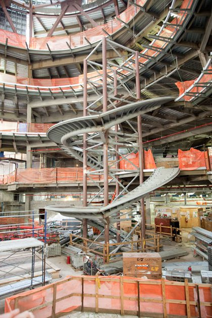 These spiral stairs will wrap around an elevator- the entire complex is wheelchair accessible.