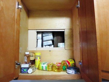 Hidden trap in kitchen cabinet