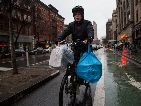 Delivery cyclist Dong Shixiang, delivering food on his e-bike last year