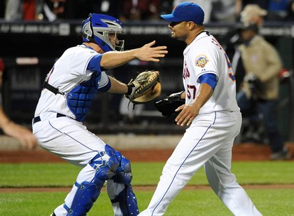 Mets catcher Josh Thole running to Johan Santana after he completed the no hitter