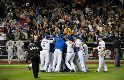 Mets players and staff embrace Santana