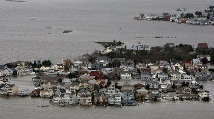 """Here's <a href=""""http://gothamist.com/2012/10/31/photos_sandy-decimated_new_jersey_s.php"""">how the Jersey Shore looked</a>: on the bay side of Seaside, N.J.(Governor Christie's Facebook)"""