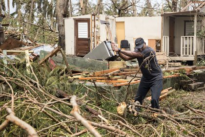 A resident clears debris days after Hurricane Maria made landfall in Loiza, Puerto Rico. (Alex Wroblewski/Getty Images)