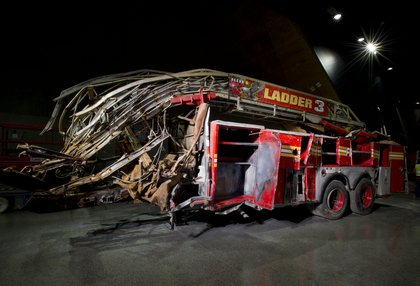 Ladder Company 3's truck; 11 members of FDNY Ladder Company 3 responded to the attacks and they were known to have reached the 35th floor by 9:21 a.m. All members were killed when the tower collapsed at 10:28 a.m. (the front cab of this fire truck was shorn off by the tower's debris). <br/>