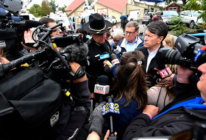 Schoharie County Sheriff Ronald Stevens,left, New York State Sen. James Seward,center, and Rep. John Faso, R-N.Y.,speak to reporters at the scene of Saturday's fatal limousine crash in Schoharie, N.Y., . A limousine loaded with revelers heading to a 30th birthday slammed into an SUV parked outside a store, killing all people in the limo and two pedestrians.<br>