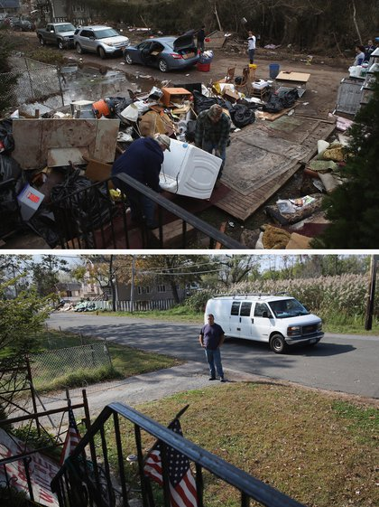 [Top] Members of the Hague family try to salvage a washing machine from their flood-damaged home after Hurricane Sandy on November 1, 2012 in the Ocean Breeze area in the Staten Island borough of New York City. [Bottom] Neighbor Frank Moszczynski watches over the Hague family home, still uninhabited almost a year after Hurricane Sandy October 17, 2013.