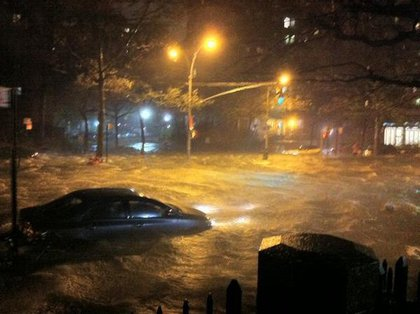 """Cars floated through the streets of Manhattan <a href=""""http://gothamist.com/2012/10/29/photos_cars_are_floating_through_fl.php"""">as it was flooded</a>"""