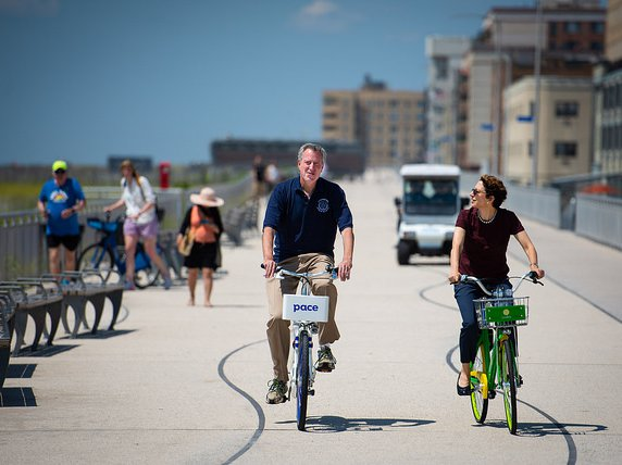 Mayor de BIKEio rides with his Transportation Commissioner Polly Trottenberg straight into the gates of Hell