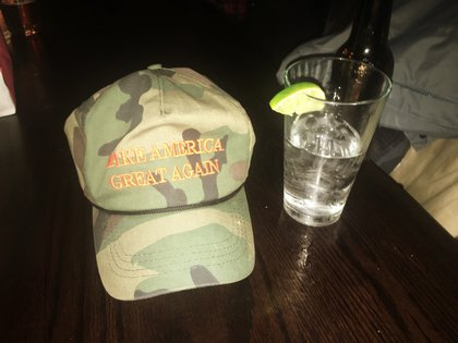"""The owner of this hat declined to pose for a picture or give his name. """"I can't even donate to the campaign because there would be professional repercussions against me,"""" he said. He wasn't interested in hearing about Trump's sexual harassment past or Clinton's emails."""